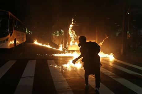 POLICE: BRAZIL PROTESTERS BEAT UP OFFICER