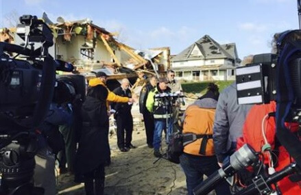 Latest on tornadoes: Chicago airports cancel fewer flights