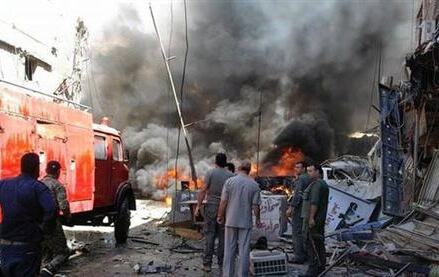 Syria TV: Twin explosions near Damascus kill 8, wound 13